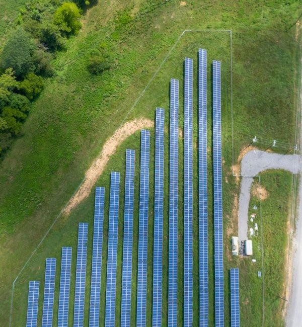 aerial-view-of-solar-panels-array-on-green-grass